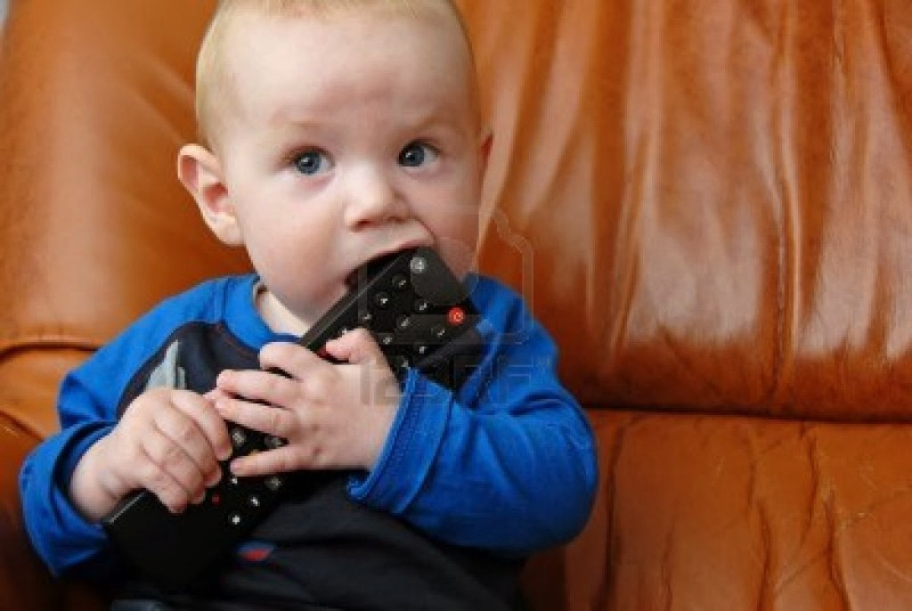 4926648-adorable-baby-boy-chewing-a-tv-remote